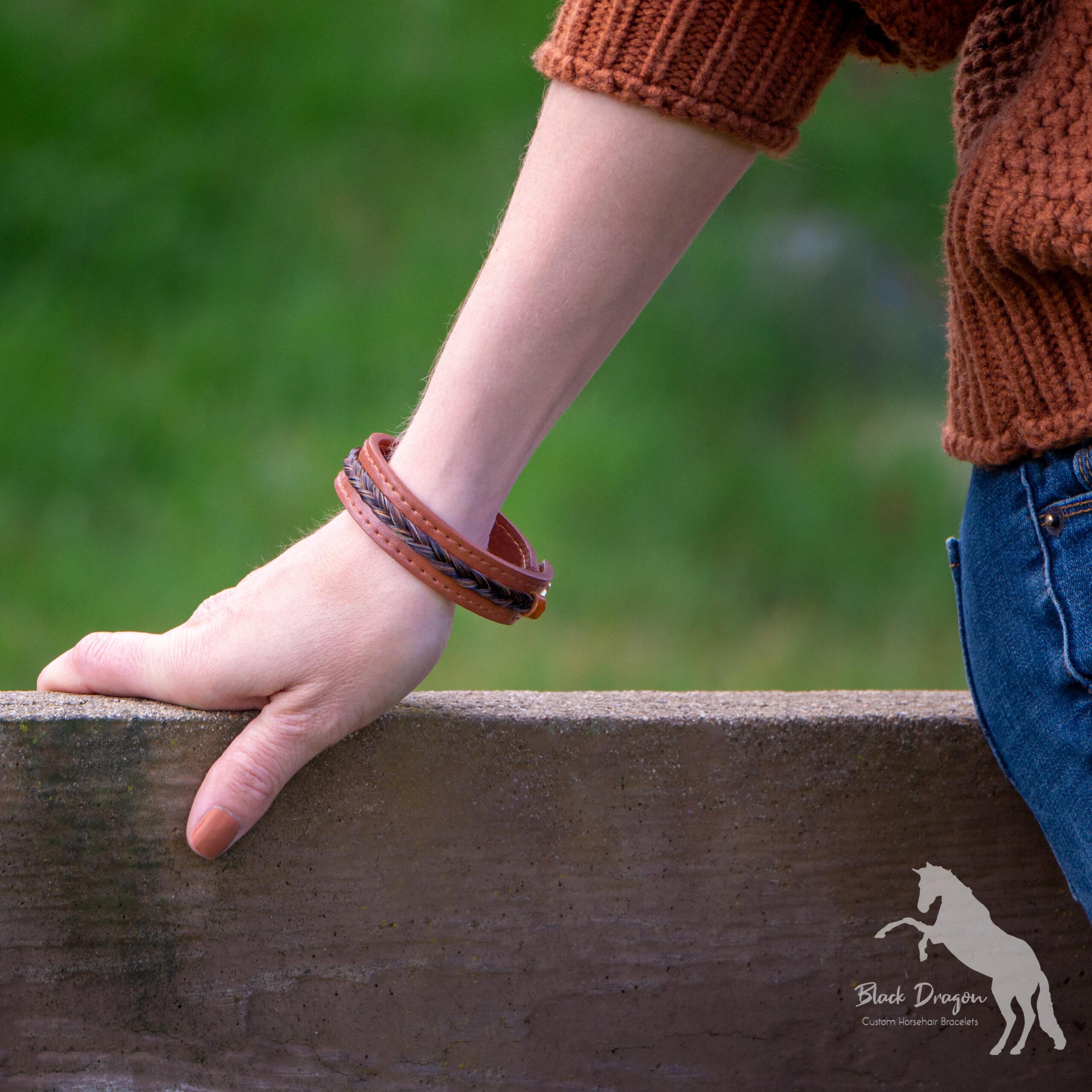 Woman's wrist wearing cognac horsehair bracelet