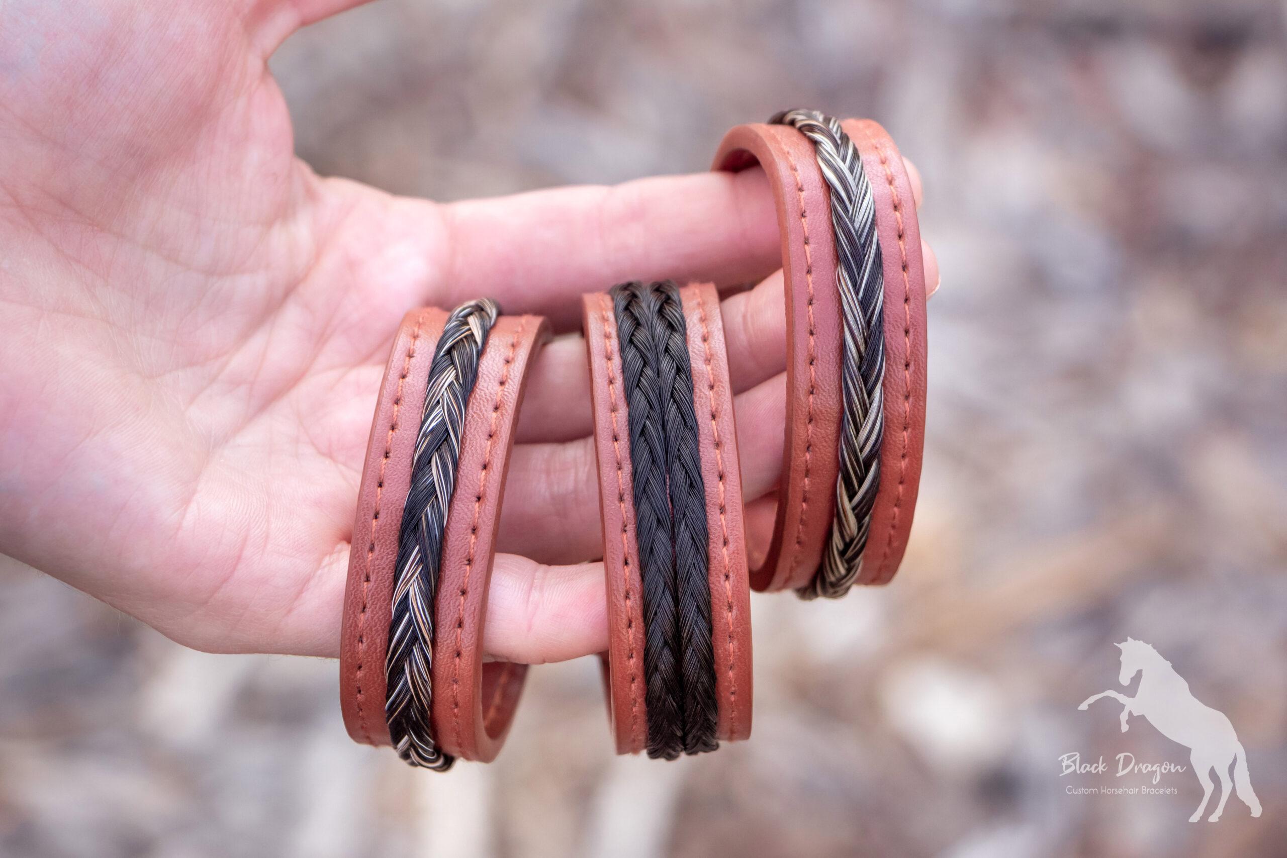 Hand holding three cognac horsehair bracelets